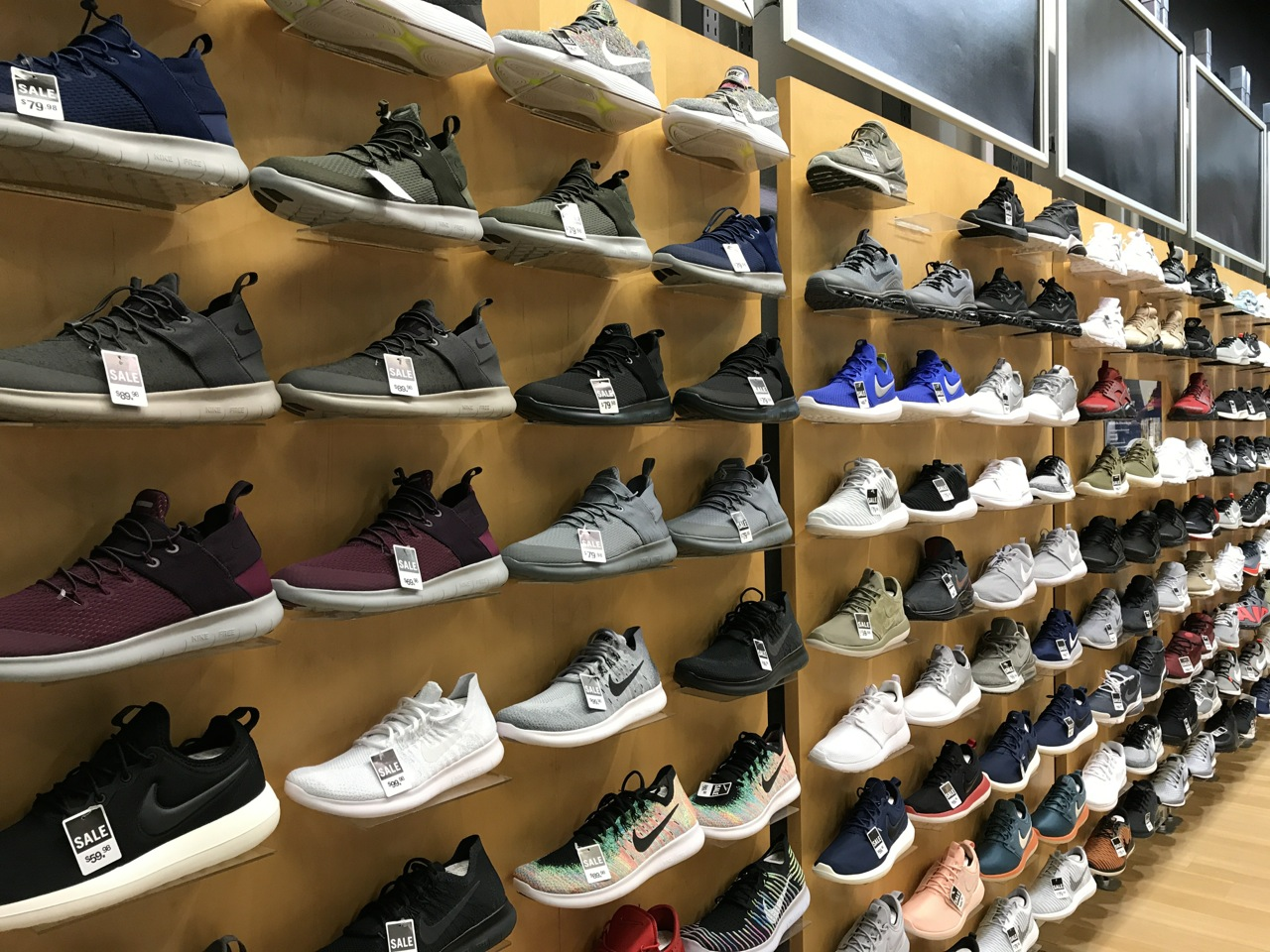A wall of Nike shoes on sale at Finish Line