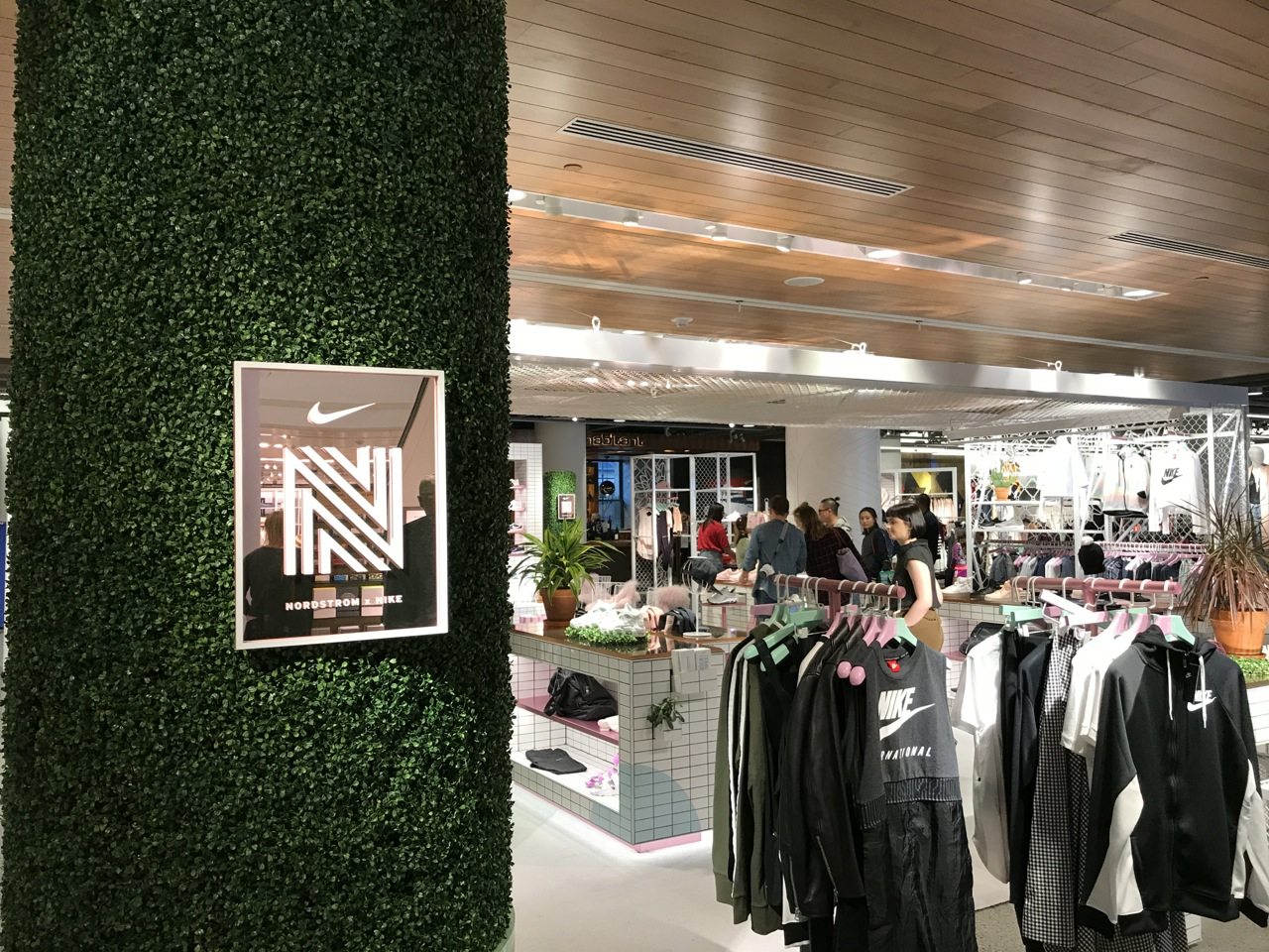 Columns with greenery set apart the Nordstrom x Nike section f66c1a864