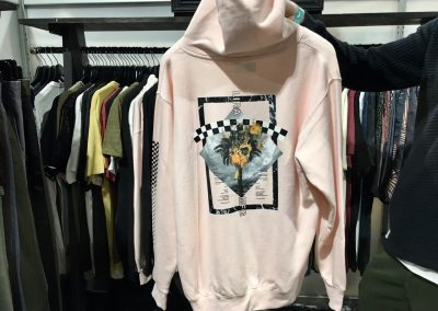 This  dusty pink Lira women's hoodie features the popular boyfriend fit and checkered pattern