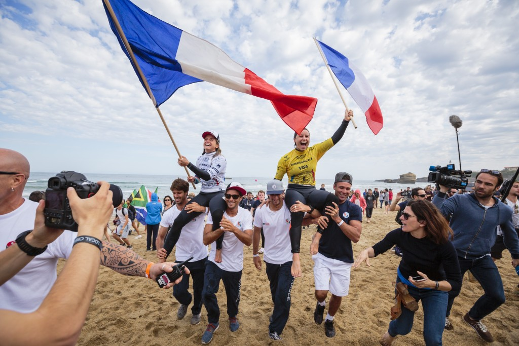 WSL CT surfers Pauline Ado and Johanne Defay rejoice upon respectively earning the Women's Gold and Silver Medals for Team France at the 2017 ISA World Surfing Games held in Biarritz. Photo: ISA / Ben Reed