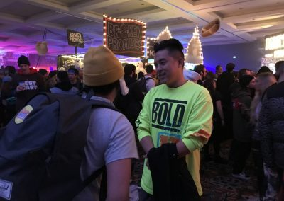 Bobby Hundreds talking to a fan at the party