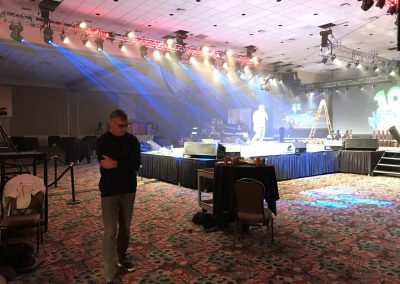 CEO Rick Brooks pacing during the show rehearsal.