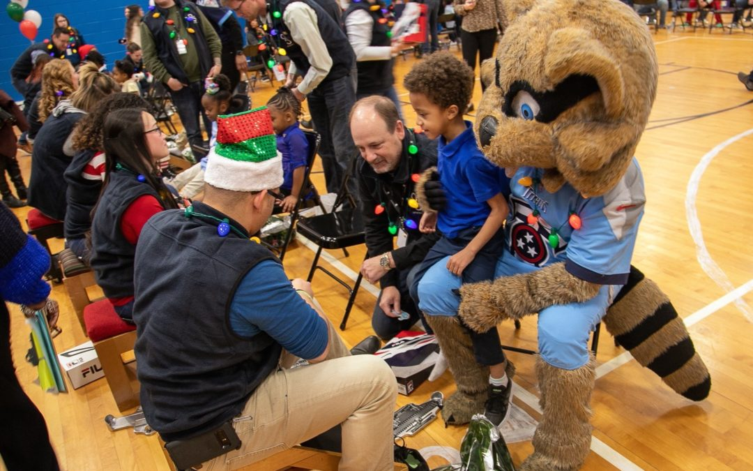 Genesco Fits 400 Children With New Footwear For the Holidays